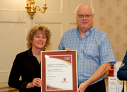 Erin O'Flynn, first recipient of the Queen's IRC Advanced HR Certificate, and Queen's IRC Director Paul Juniper